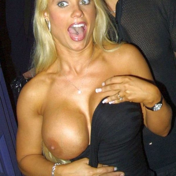 A very surprised Coco Austin feels her tits rip her dress!